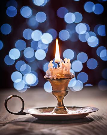gloving up: gloving vintage candle on board close up. Stock Photo