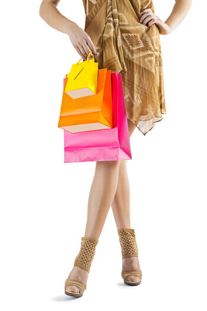 paper bags: close up female legs and paper bags. Stock Photo