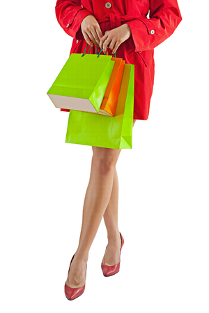 paperbags: female holding paperbags isolated on white.