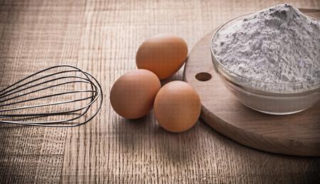 corolla: corolla eggs flour in bowl on chopping board.