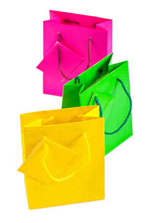 paperbag: colored paper bags isolated on white.