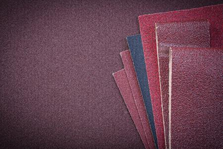 emery: Heap of abrasive paper on polishing sheet.