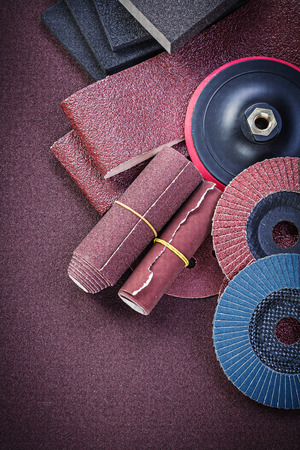 emery paper: Collection of abrasive materials on polishing paper top view.