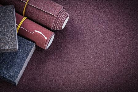 emery paper: Emery paper rolls sanding sponges on polishing sheet abrasive materials.