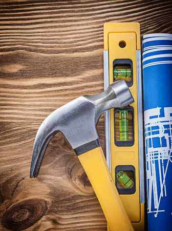claw hammer: Construction level engineering drawing claw hammer on vintage wooden board. Stock Photo