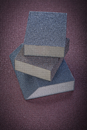 emery paper: Abrasive sponges on emery paper vertical view.