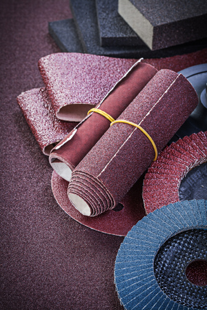 emery paper: Collection of abrasive tools on sandpaper top view.