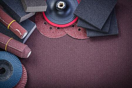 abrasive: Set of abrasive materials on polishing sheet horizontal view. Stock Photo