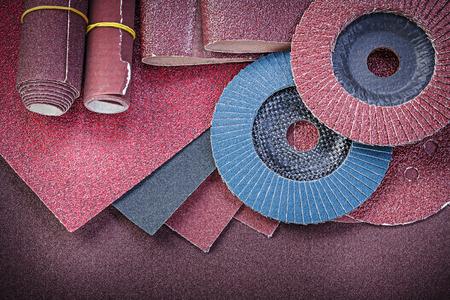 buffing: Stack of abrasive tools on polishing sheet.