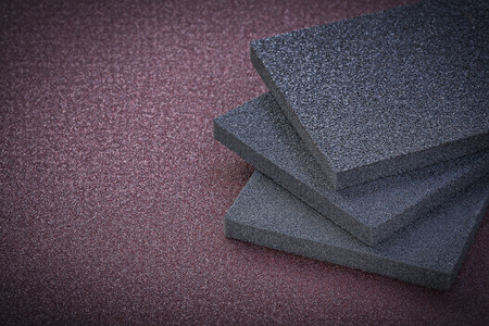 emery paper: Collection of abrasive sponges on emery paper copy space.