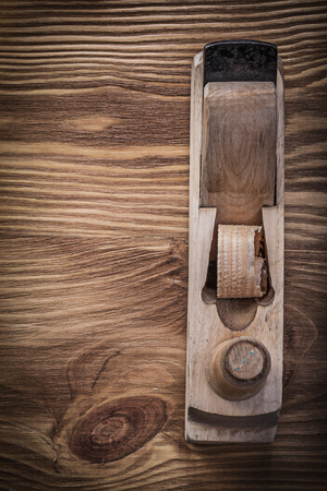 planer: Planer on vintage wooden board construction concept.