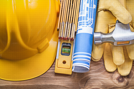 drawing up: Engineering drawing hard hat safety gloves claw hammer wooden meter construction level.