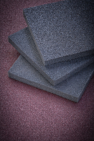 emery paper: Collection of sanding sponges on emery paper abrasive tools.