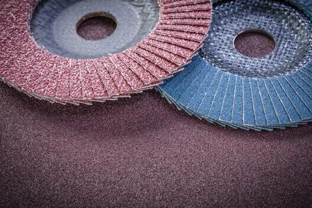 emery: Flap grinding wheels on sandpaper sheet abrasive materials. Stock Photo