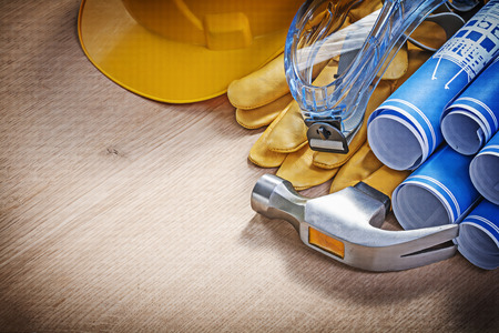 protective spectacles: Composition of safety workwear construction tools on wooden board. Stock Photo