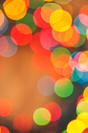 brightly: brightly colored holiday background bokeh. Stock Photo