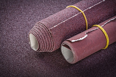 emery paper: Rolled up sand paper top view abrasive tools.