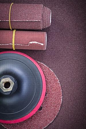 emery paper: Glass-paper rolls sanding discs on polishing sheet abrasive equipment. Stock Photo