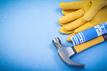 claw hammer: Claw hammer safety gloves blueprints on blue background construction concept.