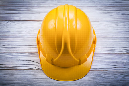 Hard hat on wooden board construction concept. Stock Photo