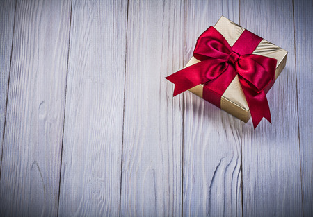 giftbox: Wrapped giftbox on wooden board holidays concept.