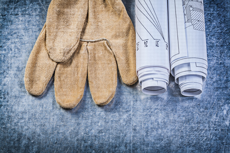 stainless steel range: Blueprints safety gloves on metallic background construction concept.