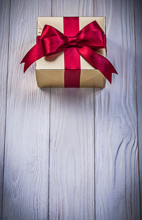 giftbox: Giftbox on wooden board top view holidays concept.