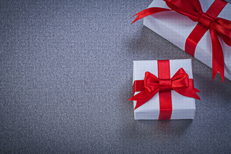 wrapped gift: Wrapped gift boxes on grey surface holidays concept.