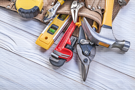 toolbelt: Leather toolbelt pliers construction level tape measure monkey wrench adjustable spanner wire cutter.