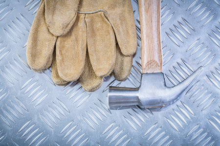 fluted: Claw hammer pair of safety gloves on fluted metal sheet construction concept.
