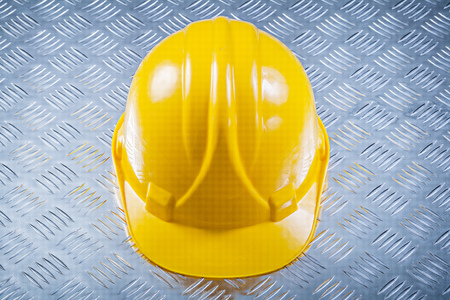 fluted: Hard hat on fluted metal background construction concept. Stock Photo