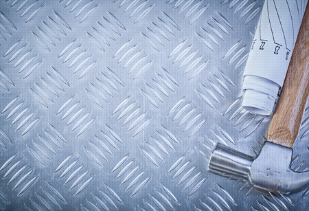 grooved: Claw hammer blueprints on grooved metal sheet copy space construction concept. Stock Photo