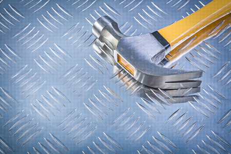 grooved: Claw hammer on grooved metal background construction concept. Stock Photo