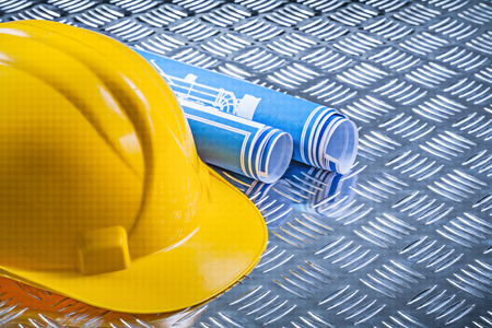 channeled: Blue engineering drawings hard hat on corrugated metal background construction concept. Stock Photo