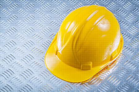grooved: Safety building helmet on grooved metal plate construction concept.