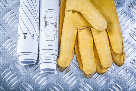 fluted: Engineering drawings leather safety gloves on fluted metal sheet construction concept.
