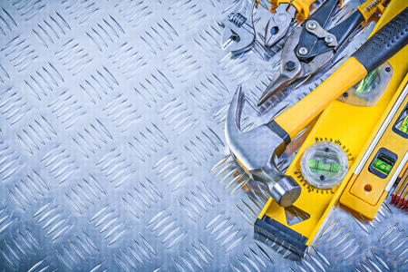 grooved: Set of construction tools on grooved metal plate maintenance concept. Stock Photo