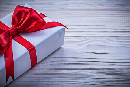 Gift box with red ribbon directly above holidays concept. Stock Photo
