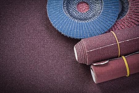 flap: Glass-paper abrasive flap wheels on polishing sheet. Stock Photo