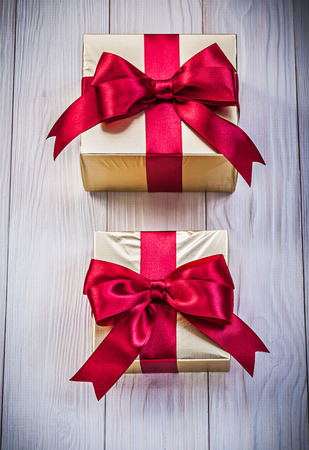 Wrapped present boxes on wooden board holidays concept. Stock Photo
