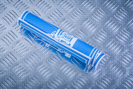 channeled: Blue blueprints on channeled metal background construction concept.