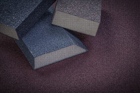 emery paper: Sanding sponges on emery paper top view abrasive tools.