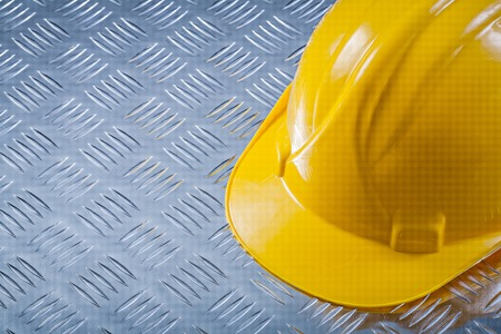 channeled: Safety hard hat on channeled metal background construction concept.