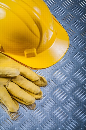 fluted: Protective leather gloves building helmet on fluted metal sheet construction concept. Stock Photo