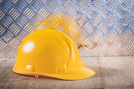 channeled: Protective building helmet wood board grooved metal sheet.