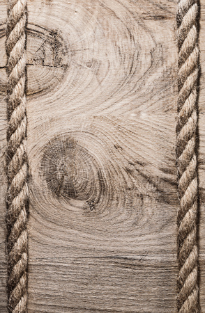 twisted: Vintage spirally twisted jute cables on wooden board vertical version. Stock Photo