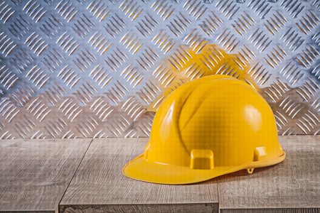 fluted: Safety building helmet wooden board fluted metal plate. Stock Photo