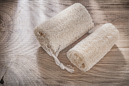 scrubbing: Scrubbing loofah on wooden board top view healthcare concept.