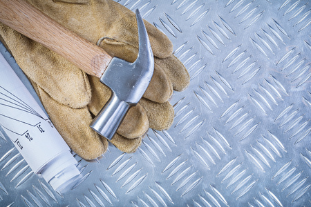 grooved: Claw hammer leather protective gloves engineering drawings on grooved metal plate construction concept. Stock Photo