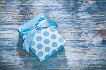 Blue present box on wooden board holidays concept.